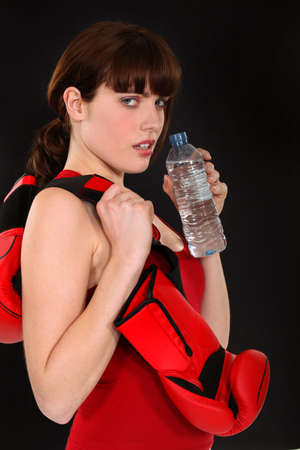 Female boxer with a bottle of water Stock Photo - 12057610