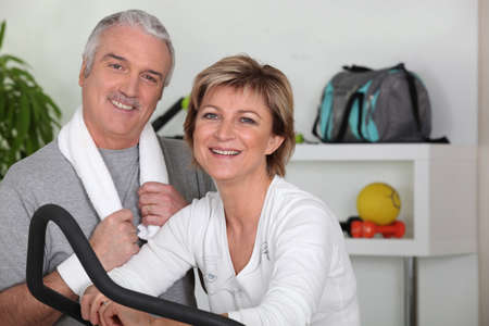 middle-aged couple going in for sport photo