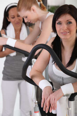 Woman exercising at the gym photo