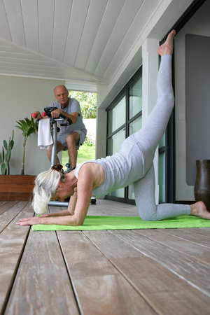 hand lifted: Senior people doing gymnastics at home