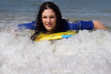bodyboarding: teen girl body-boarding Stock Photo