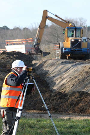 A land surveyor using an altometer photo