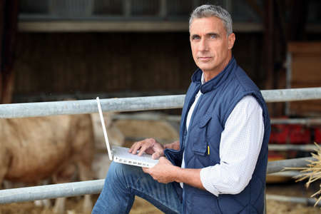 farmer working on his laptop photo