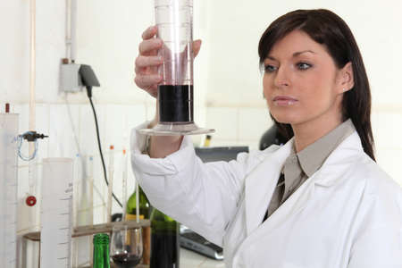 Brunette scientist in laboratory photo