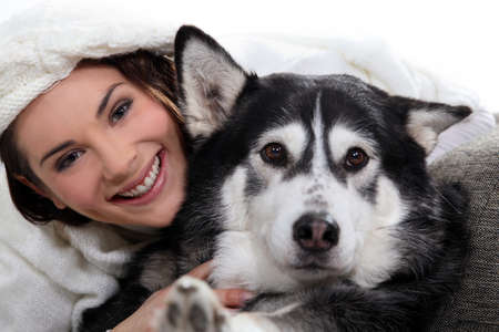 Brunette girl with dog photo