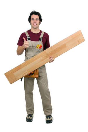 woodworker: Handyman carrying plank on white background