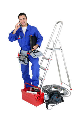 repairman: Electrician with tools and a telephone