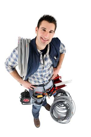 cabling: High-angle shot of a tradesman