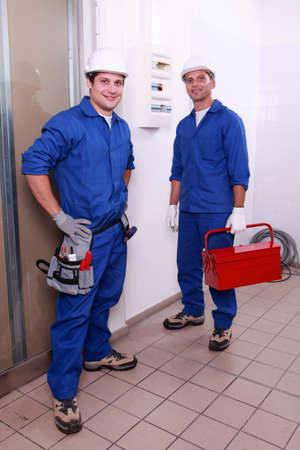men in blue collar photo