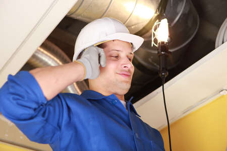 Plumber on mobile phone Stock Photo - 12088967