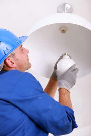 Installing a new light bulb photo