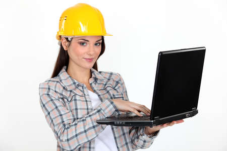 Female construction worker with laptop photo