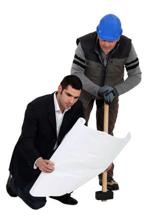 Construction worker working together with an engineer Stock Photo - 12088412