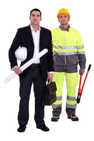 Tradesman and engineer standing side by side photo