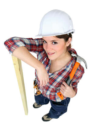 Female carpenter with a hammer photo