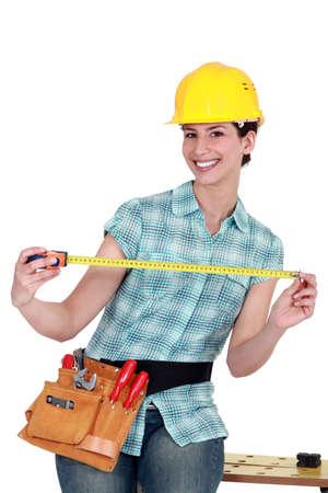 metrics: Woman holding easel