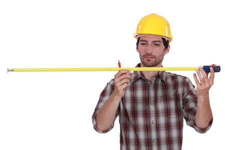 Tradesman using a measuring tape Stock Photo - 12088473