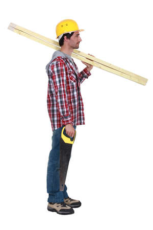 Carpenter with two planks of wood and a hand-saw photo
