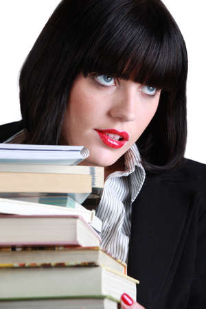 Woman with a stack of books Stock Photo - 12089885