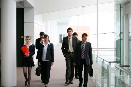 Businesspeople walking in a hallway photo