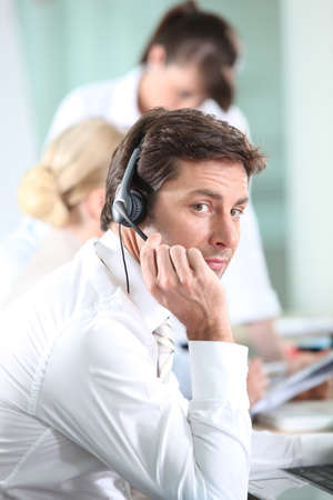 Male call centre worker photo