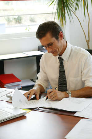 working hard: Lawyer working hard in his office Stock Photo