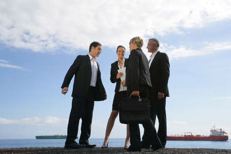A team of businesspeople meeting on the quay photo