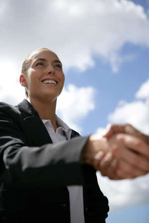 businesswoman and a partner shaking hands photo
