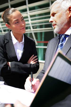 businessman signing documents: senior businessman signing documents
