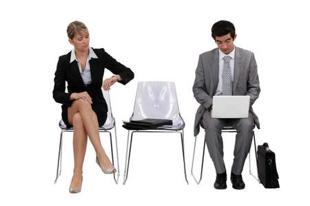 mobile communication: Two businesspeople waiting Stock Photo
