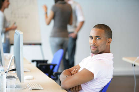 Man sitting back in an office Stock Photo - 12088600