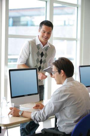 Men at an office computer Stock Photo - 12088467