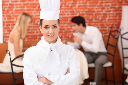 Chef stood in front of couple dining photo