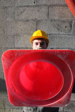 Builder holding traffic cone Stock Photo - 12090987