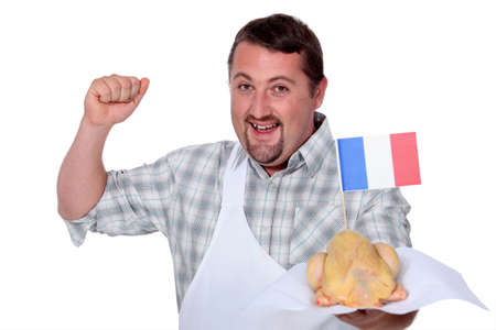 capon: Man in a white apron celebrating French poultry