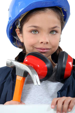 tomboy: Child with a hammer, hardhat and ear defenders