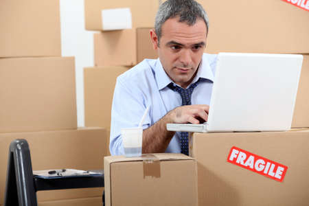 Man surrounded by boxes photo