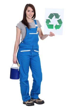 reprocess: Female painter holding recycle logo