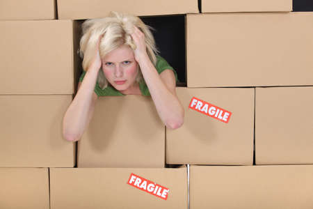 eviction: Stressed woman surrounded by boxes