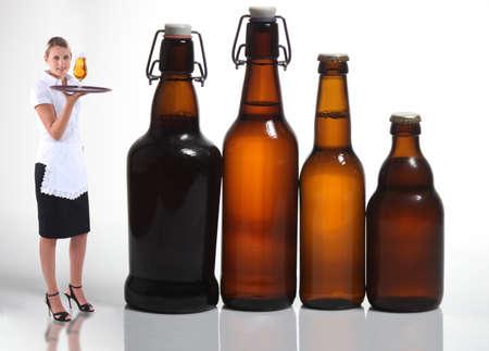 Waitress stood with beer bottles photo