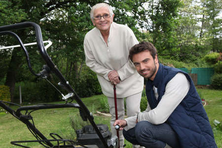 60 65 years: Son helping Mother in the garden