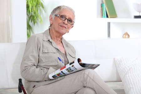 older woman on a couch Stock Photo - 12089295