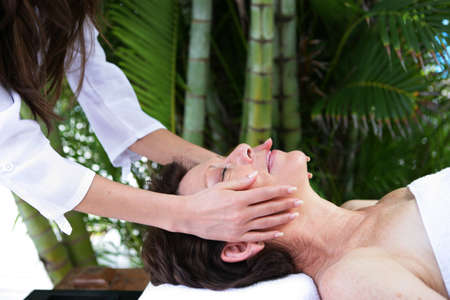 Woman having a massage at the spa photo