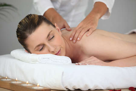denuded: woman having massage Stock Photo