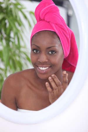 bathroom women: Woman in bathroom with towel on head