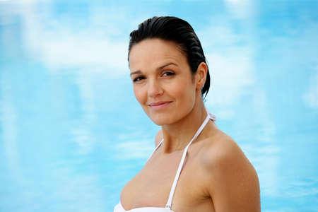 40 years old man: Beautiful woman in a swimming-pool
