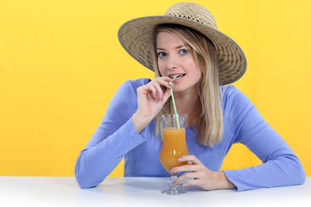 suck: Woman drinking juice though a straw
