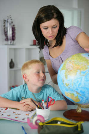 Woman giving her son a geography lesson photo