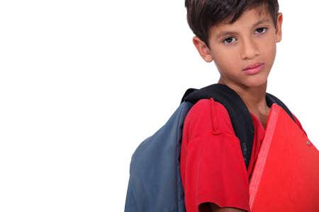 non uniform: Sulky looking schoolboy