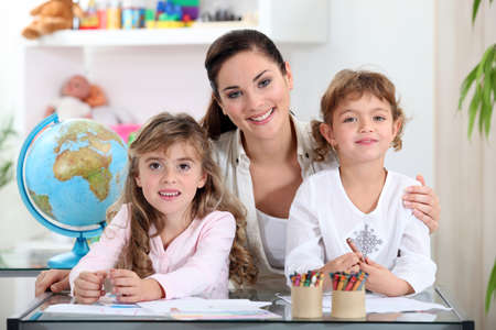 schooling: Woman with young children learning about the world